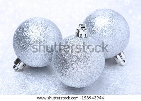 shiny christmas balls and bokeh, close-up