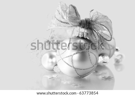 shiny Christmas decorations over white