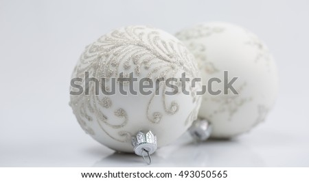 Shiny christmas round ornament on black background. #493050565