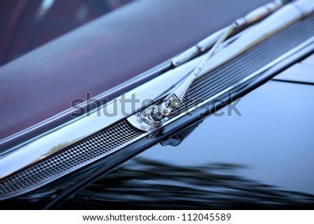 Shiny chrome coated wiper of a classic car - stock photo