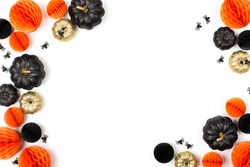 Shiny Decorative Pumpkins and Honeycomb balls. Halloween decorations. Flat lay, top view trendy holiday concept.