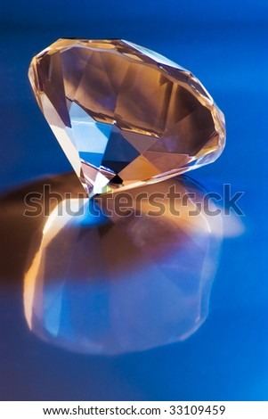 shiny diamond with reflection in blue light