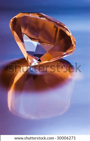 shiny diamond with reflection on blue - stock photo