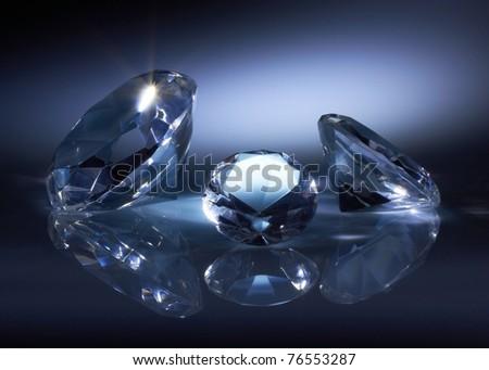 Shiny diamonds jewel on dark blue background