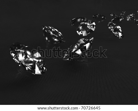 Shiny diamonds on black fabric background.