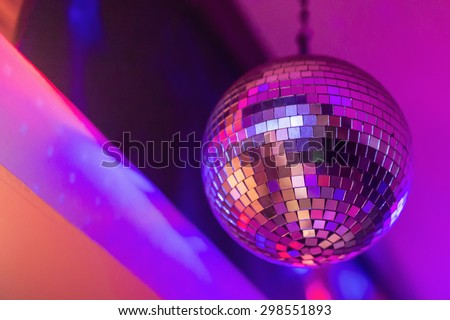 Shiny disco ball. Close up of a mirror ball hanging on the wall of a discotheque.