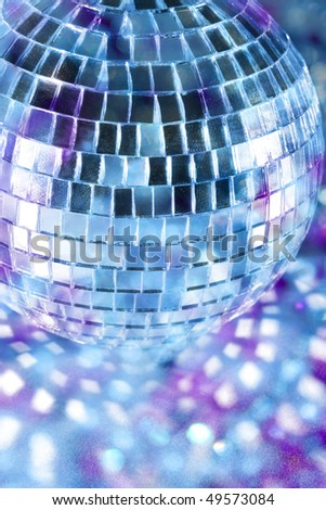 Shiny disco ball in blue light