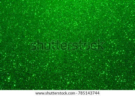 Shiny glow abstract green background. Glitter lights green background
