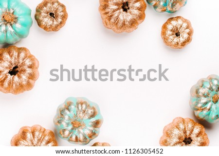 Shiny gold and blue Pumpkins. Halloween decorations. trendy holiday concept.