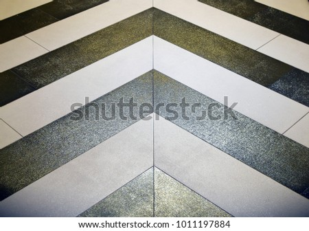 Shiny gold and silver chevron floor in hallway #1011197884