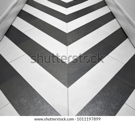 Shiny gold and silver chevron floor in hallway #1011197899