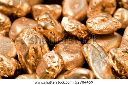 shiny gold nuggets background. closeup.