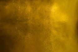 Shiny golden textured paper sheet background