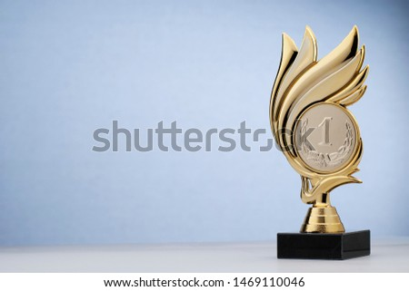 Shiny golden trophy in wreath shape with black pedestal for rewarding in competition #1469110046