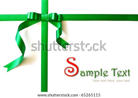 Shiny green ribbon bow on white background with copy space.