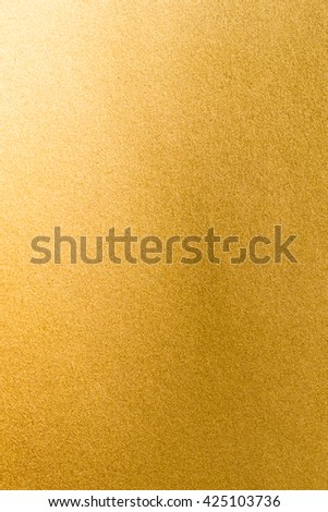 Shiny hot yellow gold foil golden texture paper with bright brilliant metallic reflective metal material surface for holiday craft gift wrapping, greeting card and design decoration element #425103736