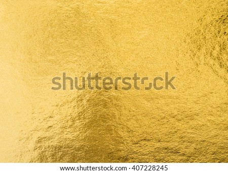 Shiny hot yellow gold golden color decorative texture paper: Bright brilliant festive glossy metallic look textured empty wallpaper backdrop: Aluminium tin metal material for craft design decoration #407228245