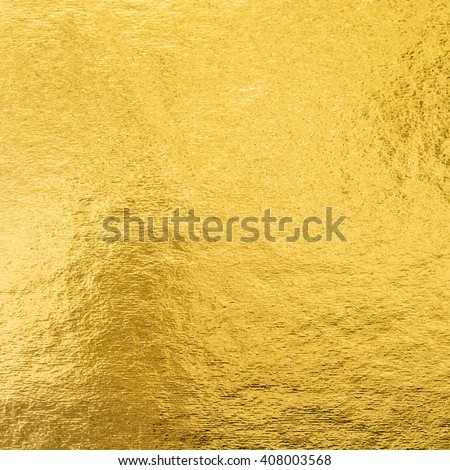 Shiny hot yellow gold golden color decorative texture paper: Bright brilliant festive glossy metallic look textured empty wallpaper backdrop: Aluminium tin metal material for craft design decoration #408003568