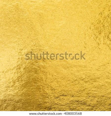 Shiny hot yellow gold golden color decorative texture paper: Bright brilliant festive glossy metallic look textured empty wallpaper backdrop: Aluminium tin metal material for craft design decoration