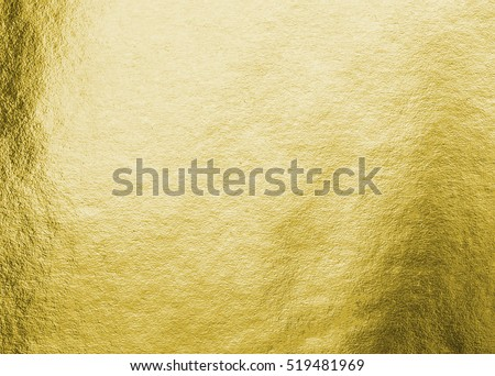 Shiny hot yellow gold golden color decorative texture paper: Bright brilliant festive glossy metallic look textured empty wallpaper backdrop: Aluminium tin metal material for craft design decoration