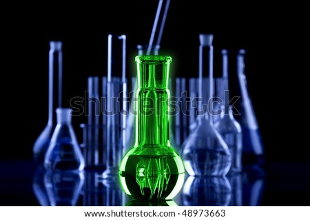 shiny magic potion in flask - stock photo