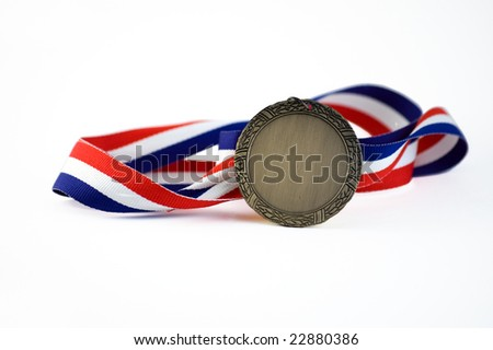 Shiny medallion with a red, white and blue ribbon