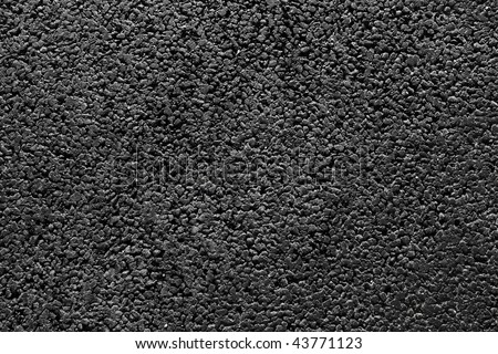 Shiny new black asphalt abstract texture background.