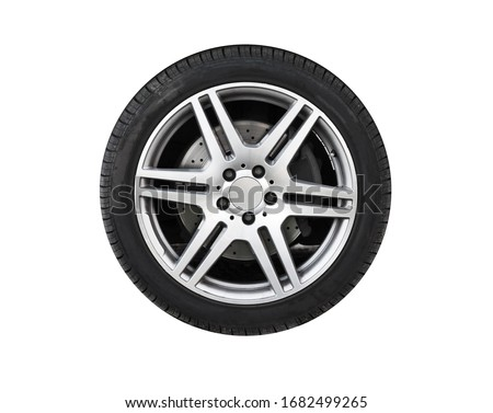 Photo of  Shiny new car wheel isolated on white background