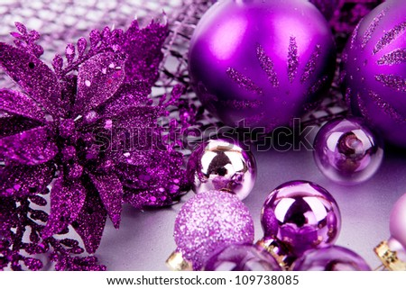 shiny purple christmas decoration on silver space for text