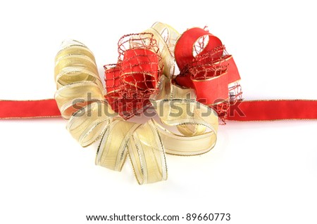 Shiny red and gold ribbon bow on white background - stock photo