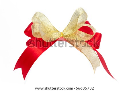 Shiny red and gold ribbon bow on white background with copy space