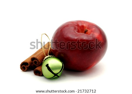 Shiny red apple and cinnamon sticks isolated on a white background.