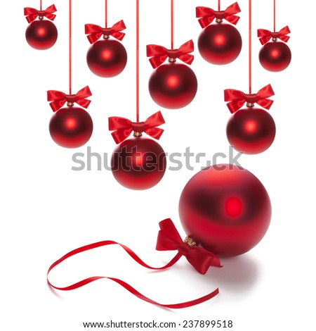 Shiny red satin ribbon and bow close up on white background. Christmas bauble  #237899518