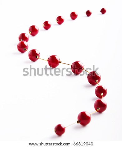 Shiny red string of beads