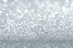 Shiny silver defocused glitter background with copy space