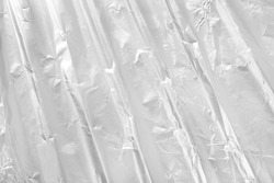 Shiny silver foil metal texture, abstract gray wrapping paper for background and design art work.