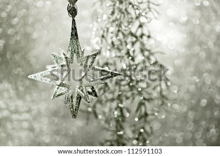 shiny silver star. christmas or new year decoration. abstract background. dark designed. selective focus