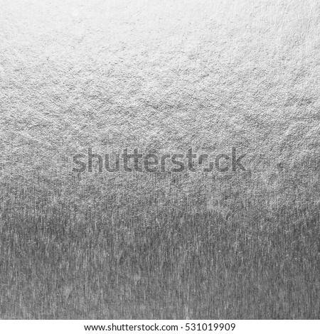 Shiny silver white grey gray bronze zinc color decorative texture paper: Bright brilliant festive glossy metallic empty wallpaper backdrop: Aluminium tin metal material for craft design decoration