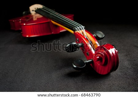 Shiny violin on dark background