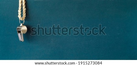 shiny whistle of a soccer referee or trainer, free copy space, panoramic soccer or football mock up