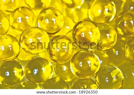 Shiny yellow capsules with fish oil