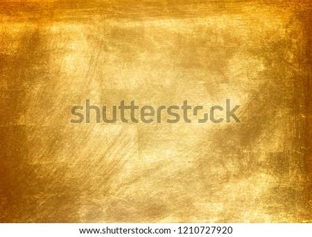 Shiny yellow leaf gold foil texture background Foto d'archivio ©