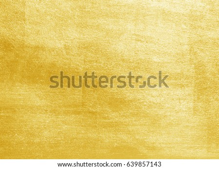 Shiny yellow leaf gold foil texture background #639857143