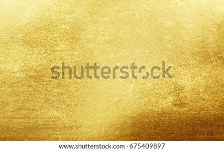 Shiny yellow leaf gold foil texture background #675409897