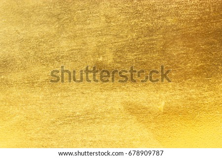 Shiny yellow leaf gold foil texture background #678909787