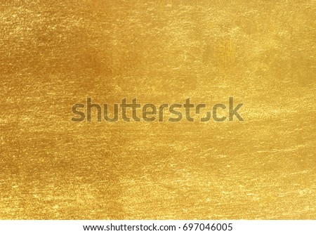 Shiny yellow leaf gold foil texture background #697046005