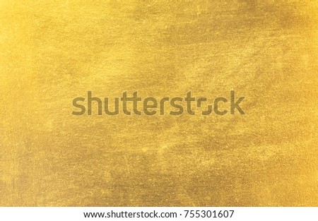 Shiny yellow leaf gold foil texture background #755301607