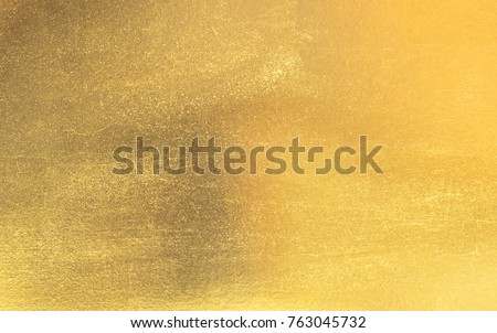 Shiny yellow leaf gold foil texture background #763045732
