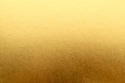 Shiny yellow metallic gold leaf foil texture background