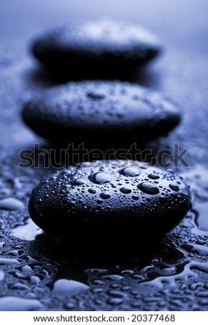 shiny zen stones with water drops - stock photo